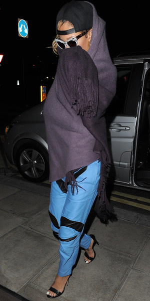 A rather camera-shy Rihanna returning to her London hotel, having caught a private jet from Manchester, following her gig at the M.E.N Arena