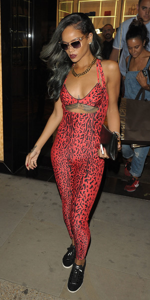 Rihanna spends around 3 hours shopping in Roberto Cavalli on Sloane Street, wearing a red Adidas leopard print jumpsuit, July 19 2013