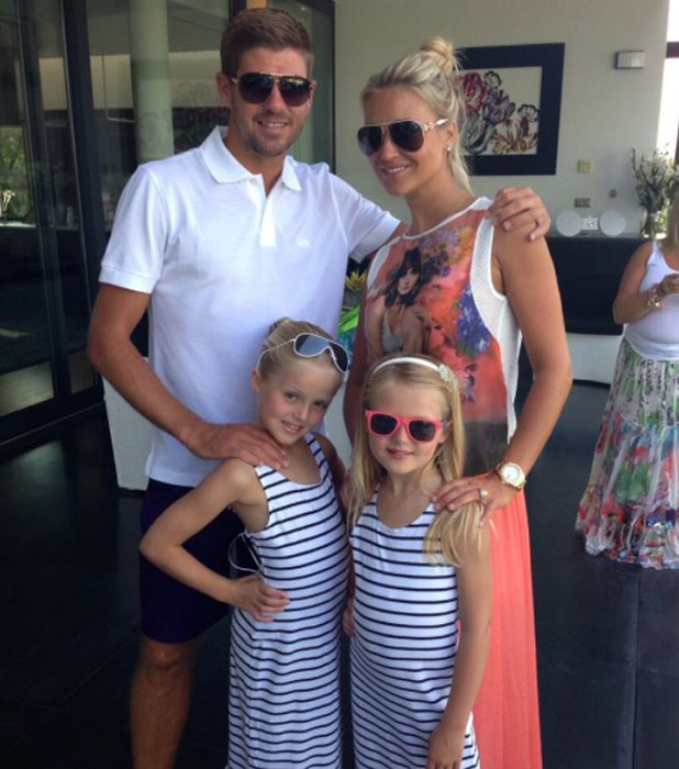 Steven and Alex Gerard pose with their daughters Lilly-Ella and Lexie, June 2013
