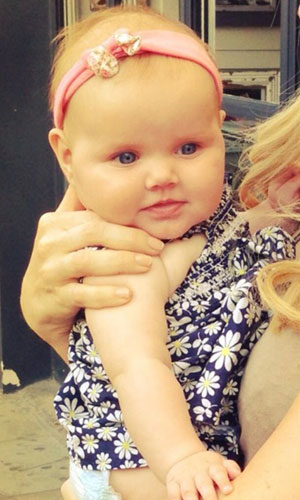 Imogen Thomas' baby daughter Ariana in a Twitter picture, July 2013