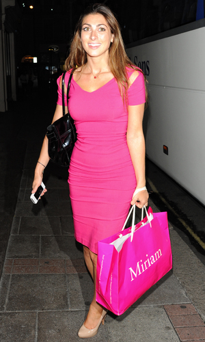 The Apprentice, Luisa Zissman arriving at May Fair hotel dressed in pink and carrying a Miriam shopping bag