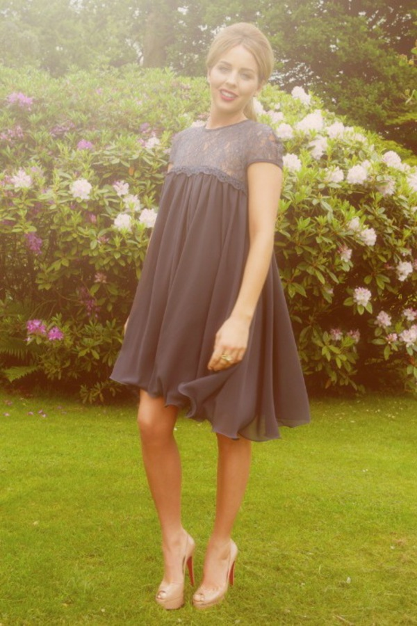 Lydia Rose Bright wearing a navy babydoll dress from her new collection for Lipstick Boutique