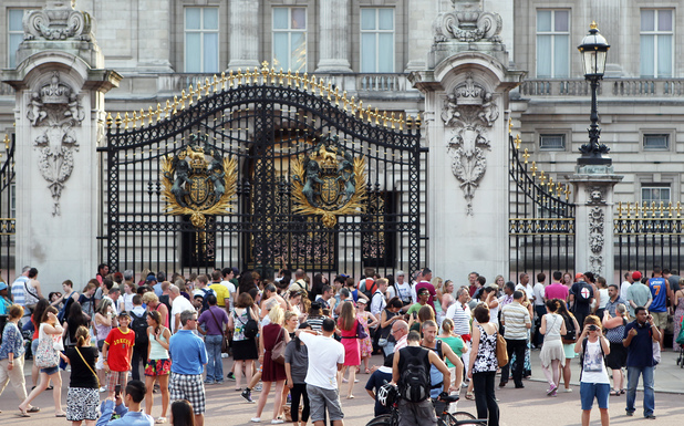 Excited crowds gather at the gates of Buckingham Palalce in anticipation for news of the arrival of the Royal baby. The world's media take the opportunity to interview people while others cooled off in the fountains of the Queen Victoria monument.
