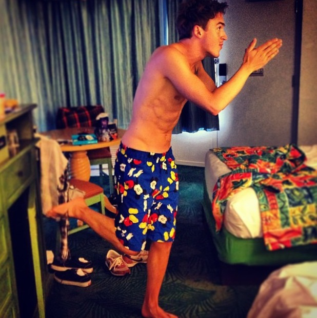 Tom Fletcher poses in Mickey mouse swimming trunks - 26 July 2013