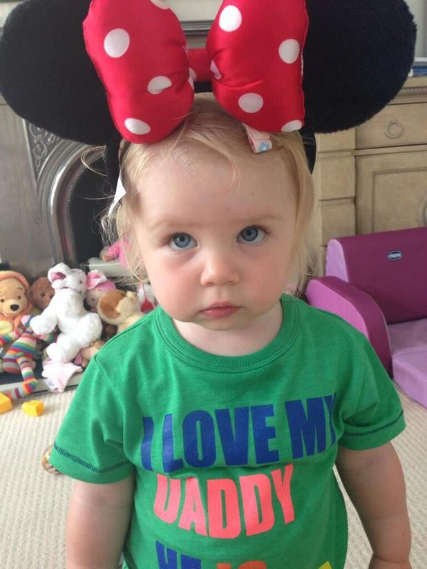 Michelle Heaton's daughter Faith looks less than impressed with Minnie Mouse ears - 25 July 2013