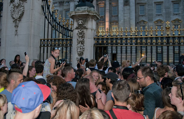 A crowd of people take photos of the easel that officially announced the birth of the son of The Duke and Duchess of Cambridge at Buckingham Palace on July 22, 2013. The Duchess of Cambridge has given birth to a baby boy at 16.24 BST, with William the Duke of Cambridge present for the arrival. A bulletin announcing the birth has been posted in the forecourt at Buckingham Palace