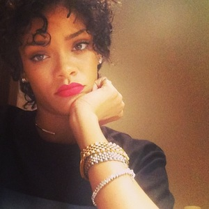 Rihanna shows off new hairstyle of tight curls - 1 August 2013
