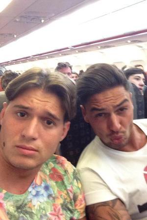Charlie Sims, Mario Falcone board plane to Ibiza - 28 July 2013