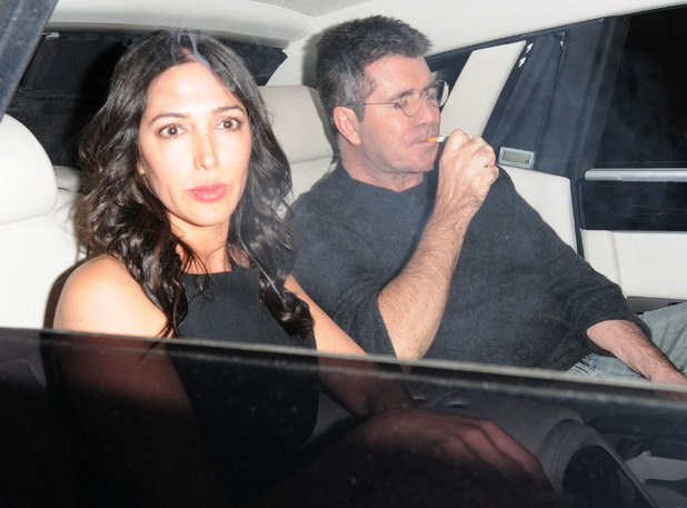 Simon Cowell leaving Saint Martin's Theatre with Lauren Silverman companions after watching the longest running show in the world, Agatha Christie's The Mousetrap - 31 July 2013