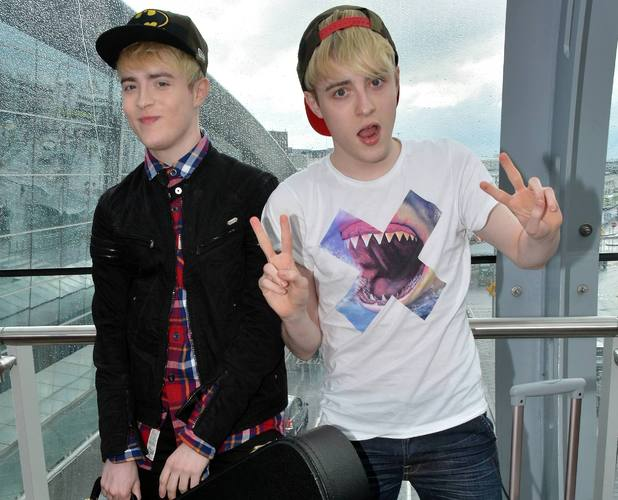 Edward Grimes and John Grimes (Jedward) get mobbed by female fans as they return to Dublin Airport after catching a flight from Manchester, Aug 2 2013