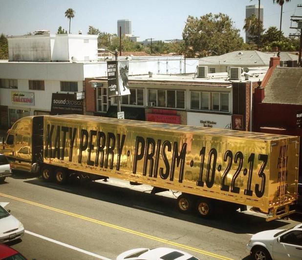 Katy Perry announces release of next album, Prism, on side of giant gold truck - July 2013