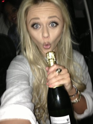 Emily Atack posts a snap of herself with a bottle on Twiiter, 29 March 2013