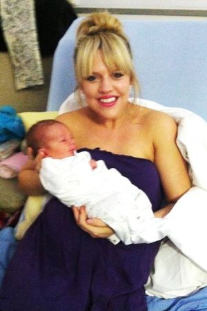 Anna Phillips with baby Bernie shortly after giving birth - looking good for labour