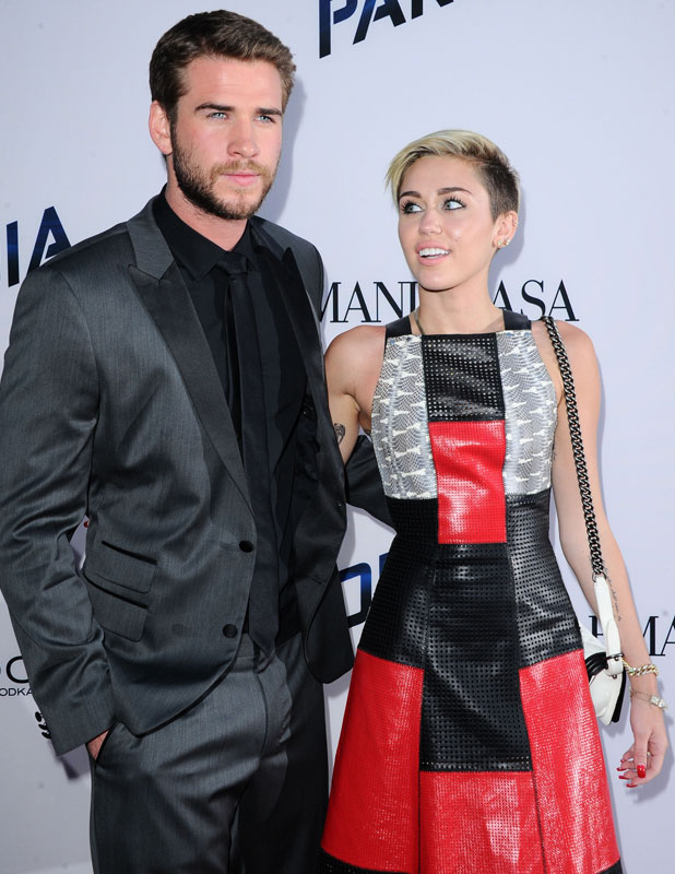 Miley Cyrus and Liam Hemsworth. Premiere of Relativity Media's 'Paranoia' at DGA Theater, 9 August 2013