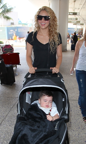 Shakira is seen arriving at LAX Airport with her son Milan Pique Mebarak for a flight. - 15 August 2013