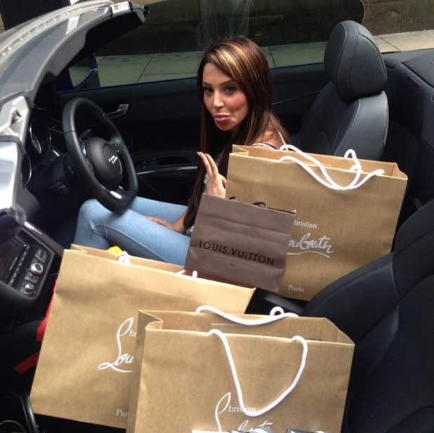 Tulisa sits in her Audi - July 2013