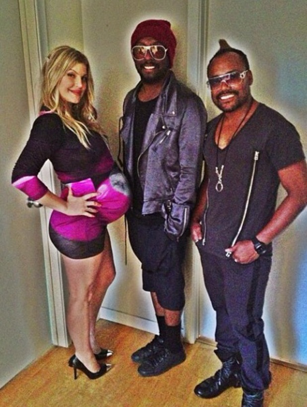 Fergie, will.i.am and apl.de.ap from Black Eyed Peas pose in photo - 11 August 2013