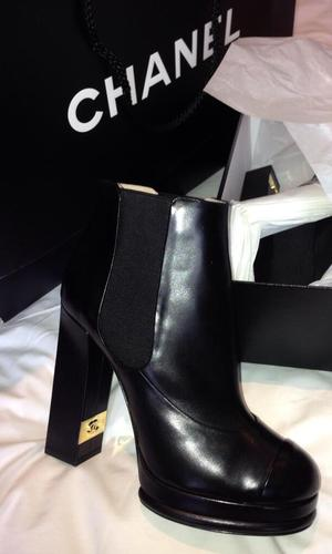 Billie Faiers shows off new Chanel ankle boots in Twitter picture on 19 August 2013