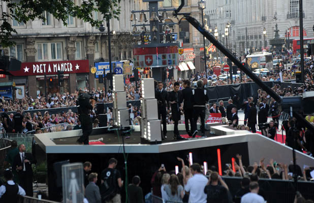 One Direction pictured on stage in Leicester Square at the premiere of their film This Is Us PersonInImage:One Direction Credit :WENN.com Special Instructions : Date Created :08/20/2013
