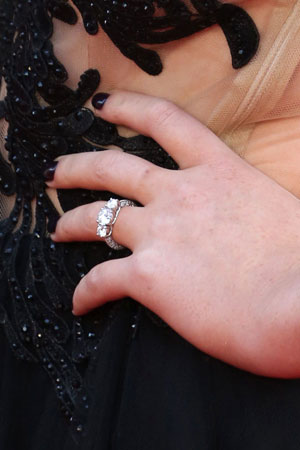 Little Mix's Perrie Edwards sparks engagement rumours with ring at the world premiere of One Direction's movie, London, 20 August 2013