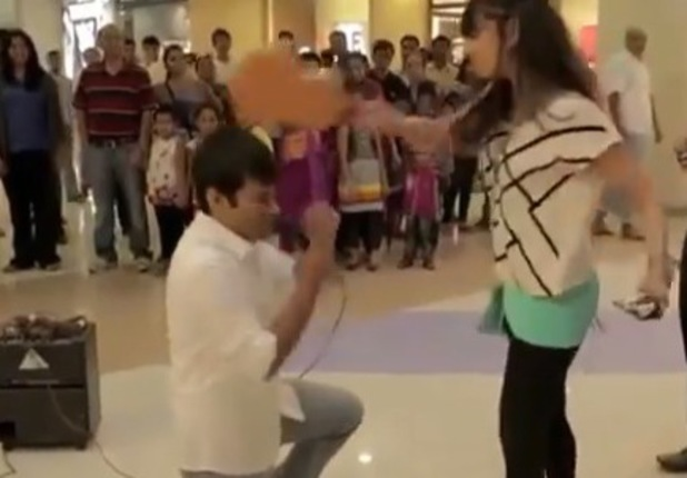 The girl is clearly unimpressed with her boyfriend's romantic gesture