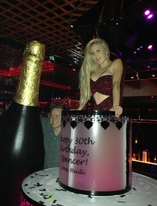 Heidi Montag emerges from Spencer Pratt's birthday cake on his 30th, 31 August 2013.
