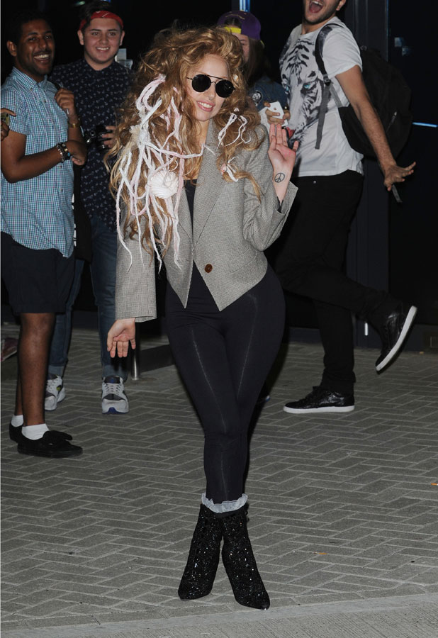 Lady Gaga greets and poses with fans as she leaves LH2 Dance Studio, 28 August 2013