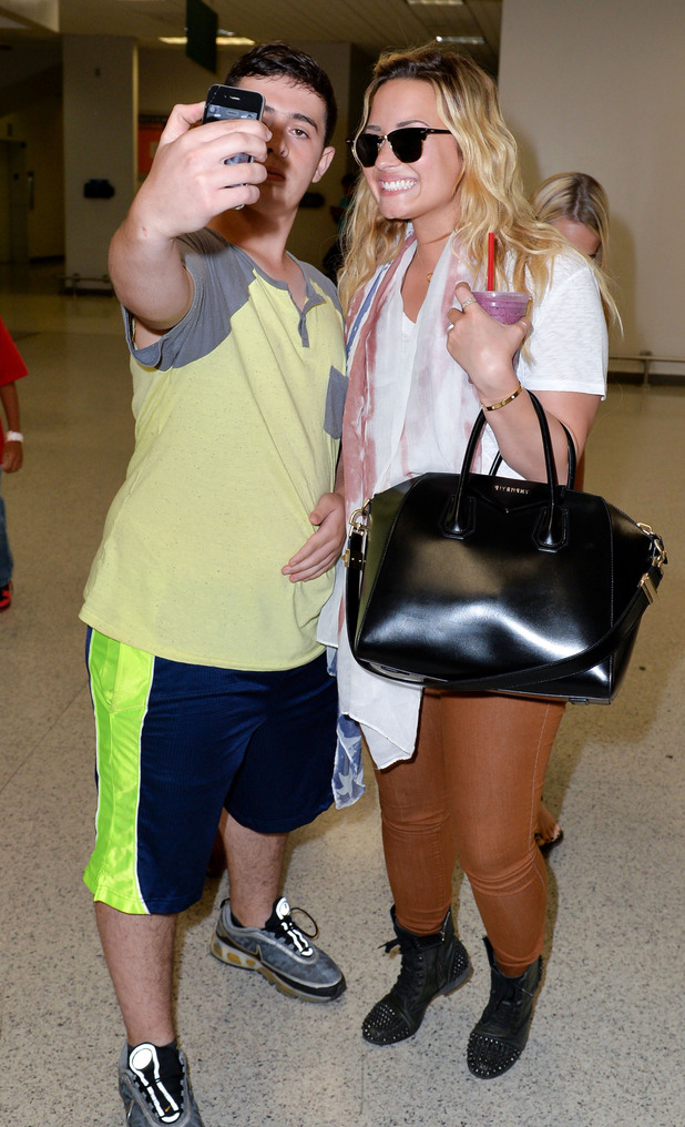 Demi Lovato and a fan at Newark Airport