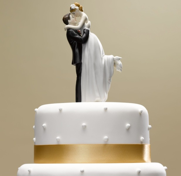 Bride and groom topper on wedding cake 2012
