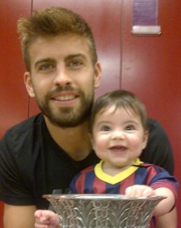 Gerard Piqué and son Milan at Camp Nou in Barcelona - 29 August 2013