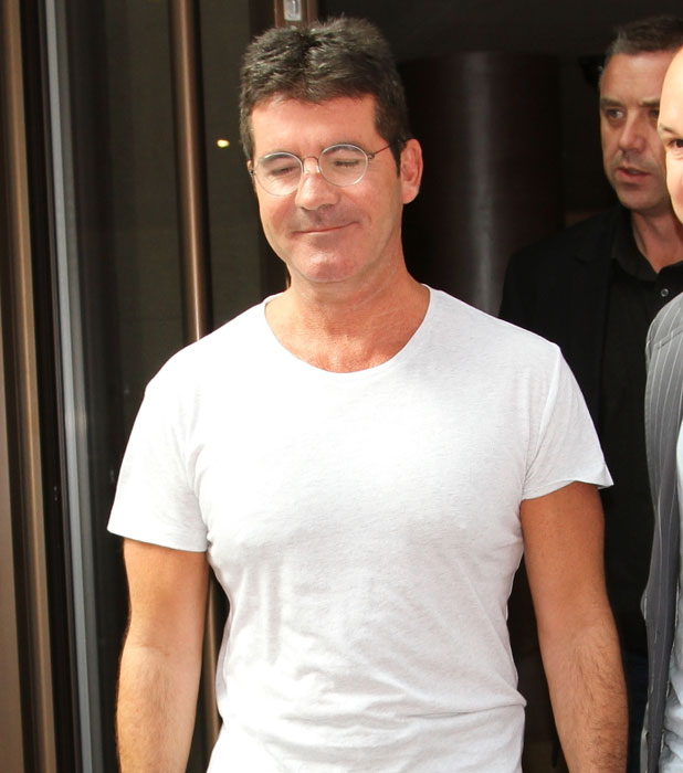 Simon Cowell leaving the X Factor press launch, 2013.