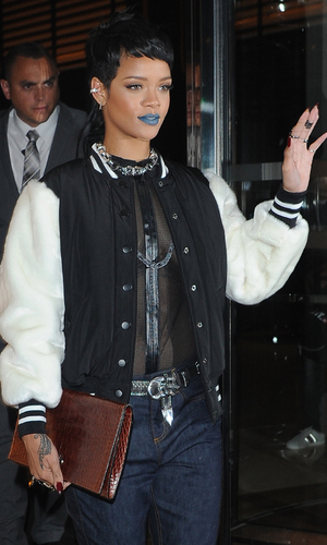 Rihanna Leaving 45 Park Lane Heading to River Island. Rihanna was seen wearing blue lipstick and a see through top as she left her hotel and headed to the launch. Rihanna Credit :Craig Harris/WENN.com