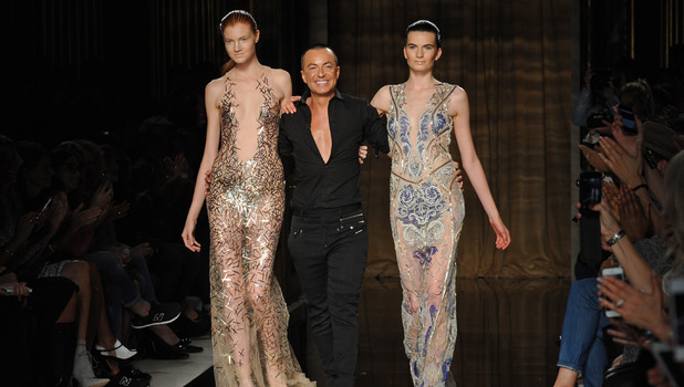 Julien Macdonald walks the catwalk with his models after his LFW show, Spring Summer 2014, 14 Sep 2013