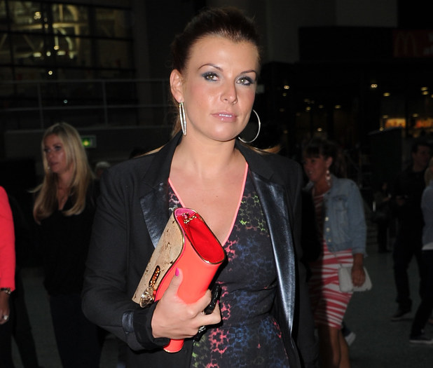 Wayne and Coleen Rooney arrive at the Rihanna concert in Manchester on their wedding anniversary. 12 June 2013