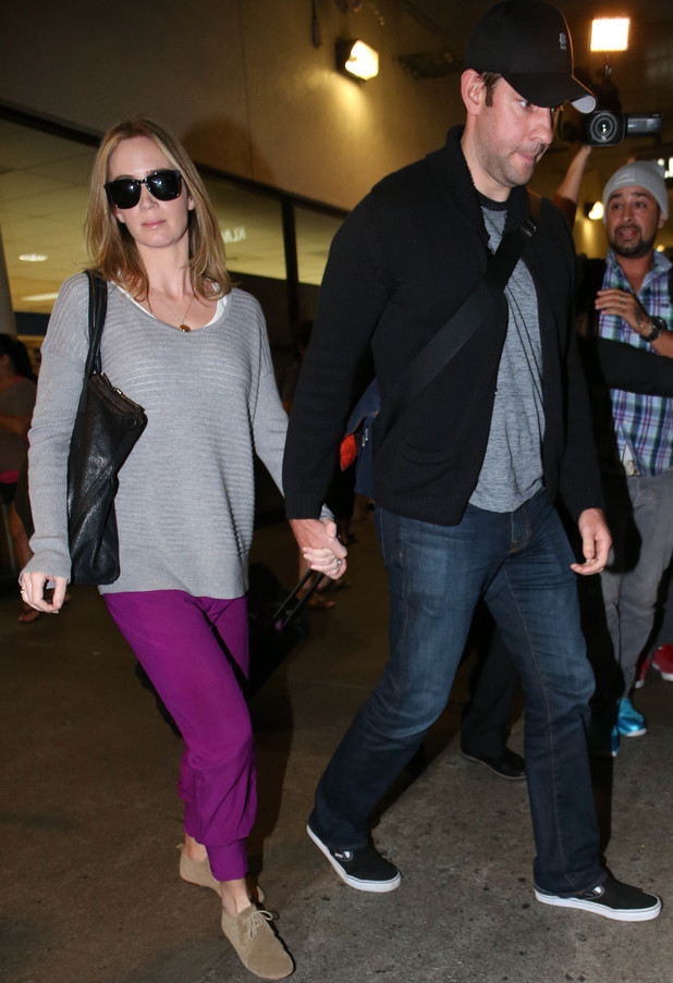 Emily Blunt and her husband, John Krasinski arrive at LAX on an international flight. 30 August 2013
