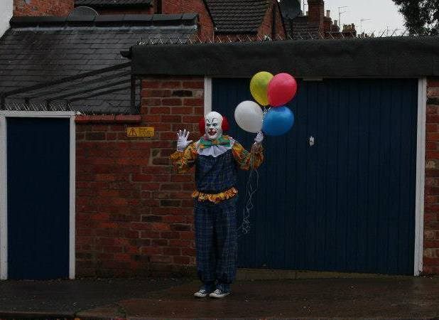 The person is dressed as Pennywise from Stephen King's film 'It'