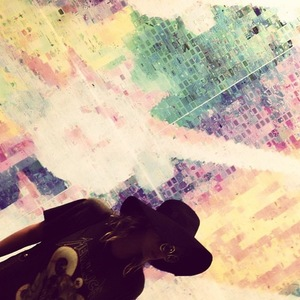 Ke$ha stands in front of a rainbow wall - 23 September 2013