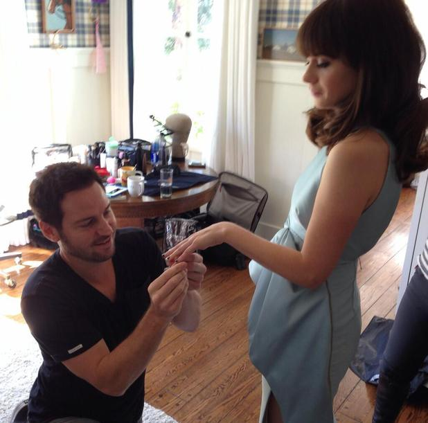 Zooey Deschanel gets her manicure done by Red Carpet Man, Tom Bachik for Emmy Awards, 22 September 2013
