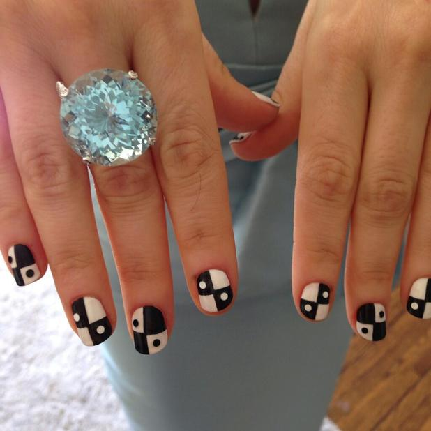 Zooey Deschanel shows off her black and white manicure ahead of Emmy Awards, 22 September 2013