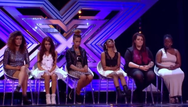 Girls sit on chairs at X Factor bootcamp 2013