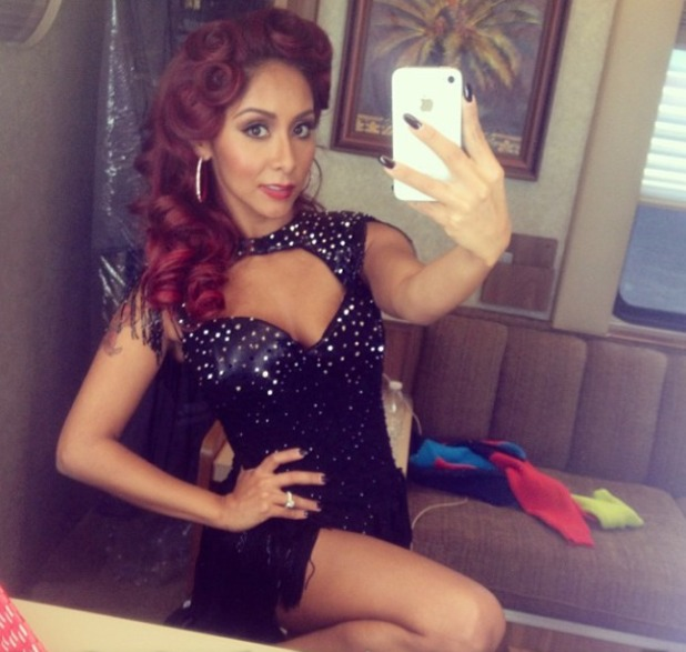 Snooki poses backstage ahead of Dancing with the Stars Hollywood night, 30 September 2013