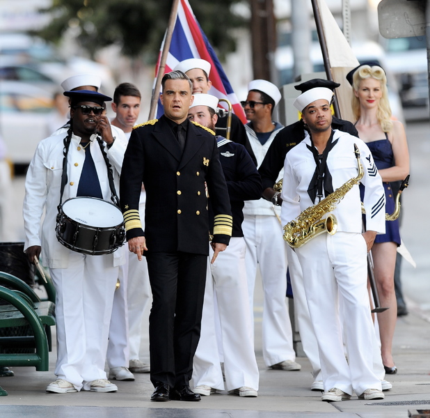 Robbie Williams wears military costume as he films the music video for new single 'Go Gentle', Oct 4