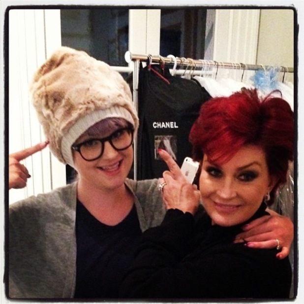 Sharon and Kelly Osbourne try on a silly hat - 2 October 2013