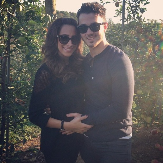 Danielle and Kevin Jonas pictured cradling baby bump in apple orchard - 29 September 2013