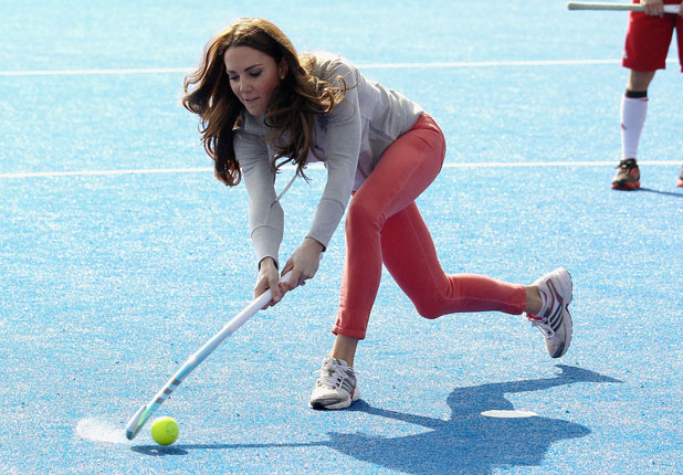 The Duchess of Cambridge, aka Kate Middleton plays hockey during a visit to Dulwich, South London London, England - 16.03.12