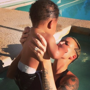 """Amber Rose goes swimming with 7-month-old son Sebastian """"Bash"""" Taylor - October 2013"""