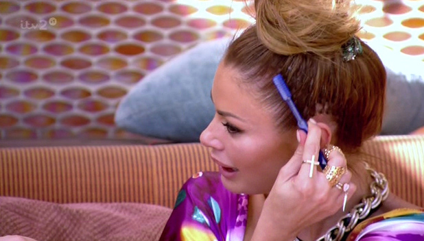 Chloe Sims is seen brushing her hair with a toothbrush on 'The Only Way Is Vegas', on ITV2