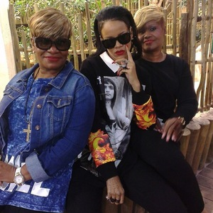 Rihanna pictured with her cousins while visiting the aquarium in Cape Town, South Africa