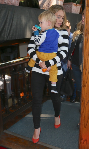 Hilary Duff Leaves Madeo Restaurant Caption:	Hilary Duff carries her son Luca Comrie in her arms as she leaves Madeos Restaurant Credit :	Michael Wright/WENN.com