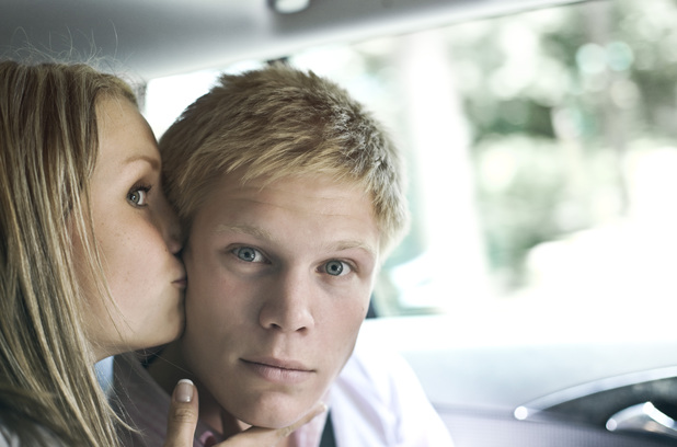Model Released - Germany, Duesseldorf, Woman kissing man in car